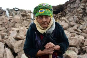 An villager stands in front of her damaged house after two earthquakes, both with preliminary magnitudes of 5.3, jolted Turkey's northern Aegean coast, in Yukarikoy village Canakkale province, Monday, Feb. 6, 2017, damaging dozens of homes in at least five villages and injuring several people.(Mustafa Suicmez/DHA-Depo Photos via AP)