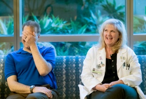 In a Feb. 23, 2017 photo, Dr. Colleen Coleman, right, laughs with at Dr. Brian Dunn as they reunite at Hoag Hospital in Newport Beach, Calif., for the first time since she donated her kidney to him. The two have been friendly more than a decade while working together. Coleman is a surgeon and Dunn is an anesthesiologist at Hoag Hospital Newport Beach. (Cindy Yamanaka/The Orange County Register via AP)