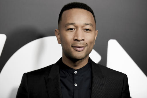 """FILE - In this Friday, Jan. 13, 2017, file photo, John Legend attends a photo call for WGN America's """"Underground"""" at the CTAM portion of the 2017 Winter Television Critics Association press tour in Pasadena, Calif. The producer of the Grammy Awards said Legend and Broadway star Cynthia Erivo will perform during the show's In Memoriam segment on Sunday, Feb. 12, 2017. They will perform the Beach Boys' """"God Only Knows."""" (Photo by Richard Shotwell/Invision/AP, File)"""