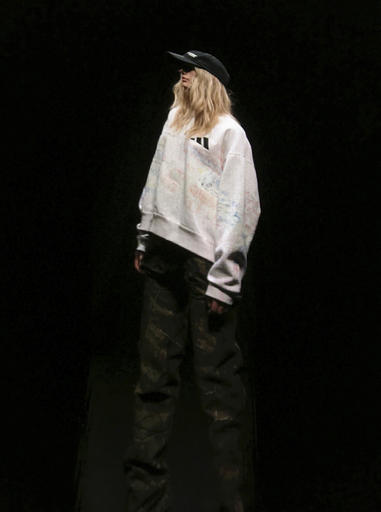 A model, in clothing by Kanye West, is projected on a giant screen during the unveiling of the Yeezy Season 5 collection during Fashion Week in New York, Wednesday, Feb. 15, 2017.  (AP Photo/Leanne Italie)