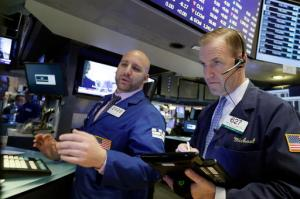 Specialist John Parisi, left, and trader Michael Smyth work on the floor of the New York Stock Exchange, Friday, Feb. 17, 2017. Stocks are posting moderate declines in early trading as a fast-paced market rally of the past two weeks goes into reverse. (AP Photo/Richard Drew)
