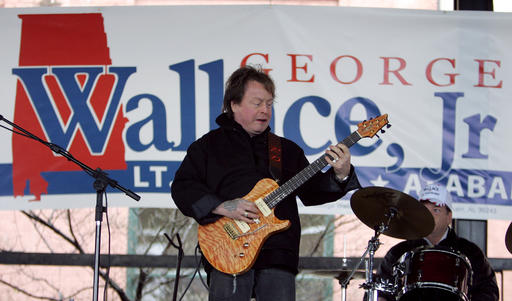 FILE - In this Feb. 18, 2006 file photo, Rick Derringer performs during a campaign rally kicking off George Wallace Jr's bid for the office of lieutenant governor in Montgomery, Ala.  Prosecutors say  Derringer carried a loaded gun in his carry-on bag on a Delta Air Lines flight from Cancun, Mexico, but was stopped after landing in Atlanta.  Derringer was charged with unlawfully entering an airport's secure area Jan. 9, 2017. His representatives didn't immediately return multiple calls and emails.  (AP Photo/Rob Carr)