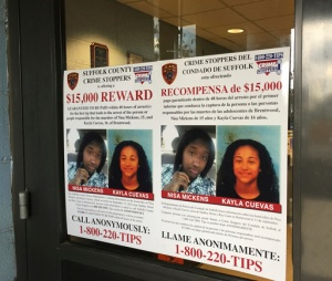 FILE - In this Oct. 24, 2016 file photo, a poster displayed at a Suffolk County police precinct in Bay Shore, N.Y., offers a $15,000 reward for information leading to the arrest of the person(s) responsible for the slayings of Nisa Mickens and her lifelong friend Kayla Cuevas. Federal agents said Thursday March 2, 2017, that they have caught the members of a violent El Salvadoran street gang who killed three teenagers last year, including the two girls who were inseparable best friends at their Long Island high school. (AP Photo/Michael Balsamo, File)