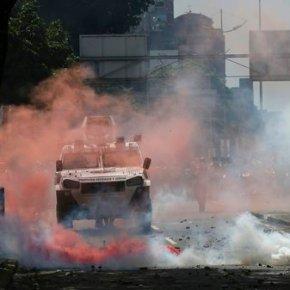 Venezuela's Maduro blasts foe for chemical attackcomments