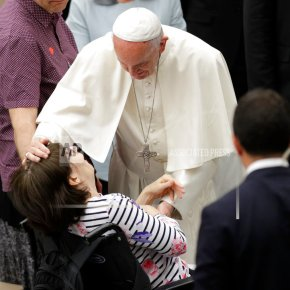 Pope embraces Huntington's afflicted in bid to end stigma