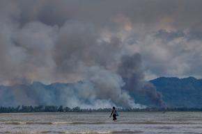 Fleeing Rohingya Muslims watch as homes burn inMyanmar