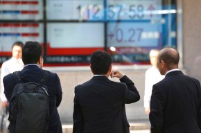 Asian shares slightly higher, though Japan isexception