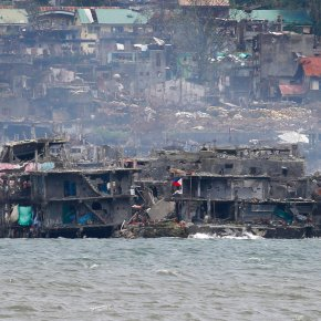A few militants fight on in Philippine city ripped toshreds