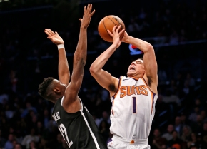 Booker scores 32, Suns rally late to beat Nets 122-114