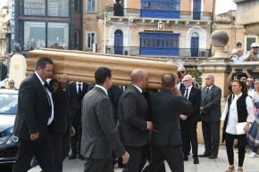 Funeral held for Malta journalist; some officials stay away