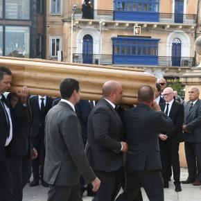 Funeral held for Malta journalist; some officials stayaway