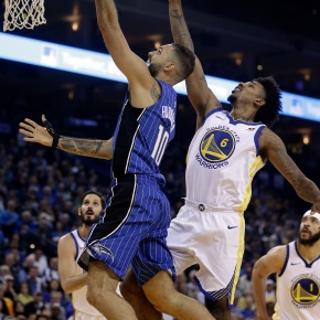 Without injured Curry, Durant leads Warriors pastMagic