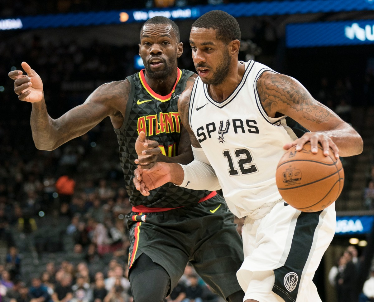 Aldridge leads Spurs to 20th straight home win over Hawks