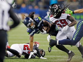Ryan's 2 TD passes enough as Falcons hold off Seahawks 34-31