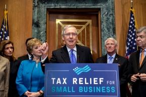 The Latest: GOP Sen. Johnson still withholding on taxbill