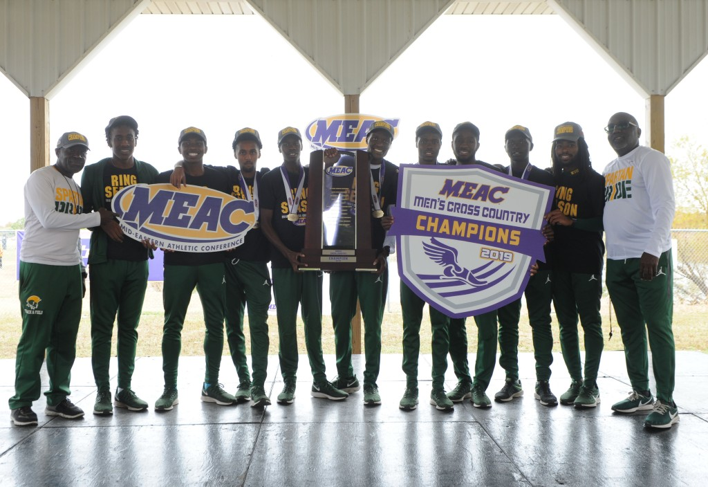 Norfolk State University Men's Cross Country Team holding MEAC Cross Country Championship trophy. Photo courtesy of NSUSpartans.com and used with permission.